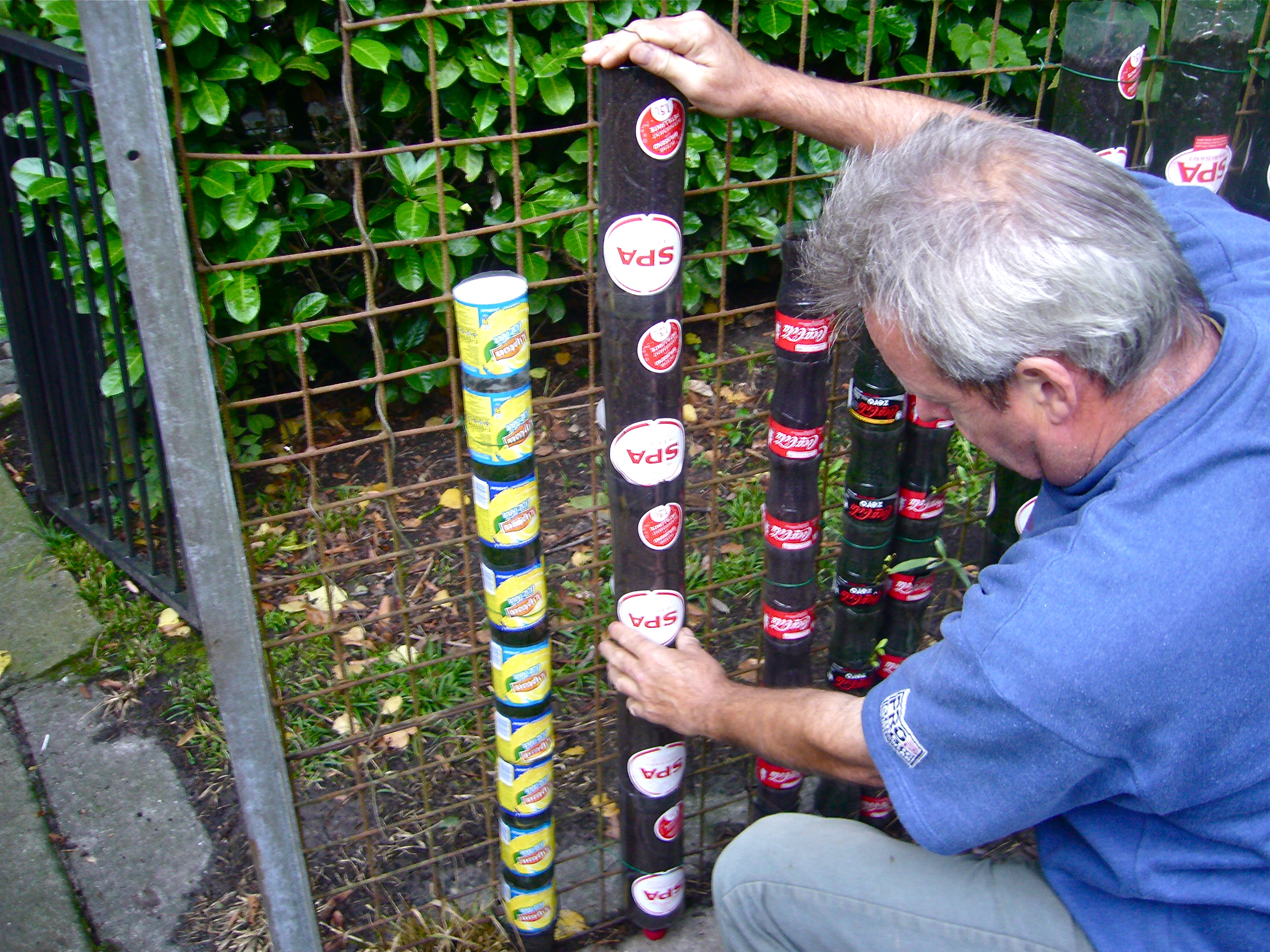 Bottle tower gardening how to start willem van cotthem container gardening - Plastic bottle vertical garden ideas ...